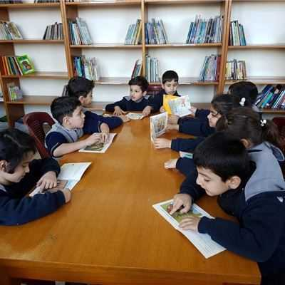 Young FMIS Students Enjoy Story Time in the Library